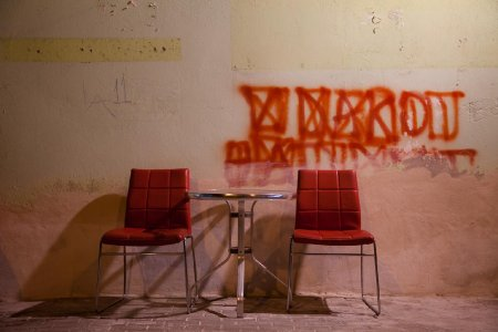 Red chairs and red graffiti