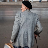 Old man crossing the street