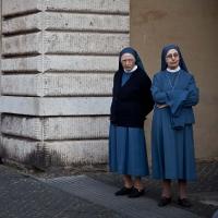 Nuns with beggar