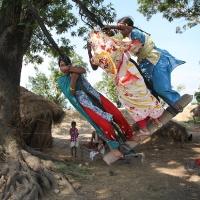 Three colourful girls on a swing, Lumbini