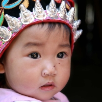 Chinese baby with crown-like headcover