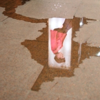 Ad reflected in puddle