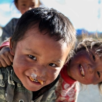 Tibetan boy with snot baloon